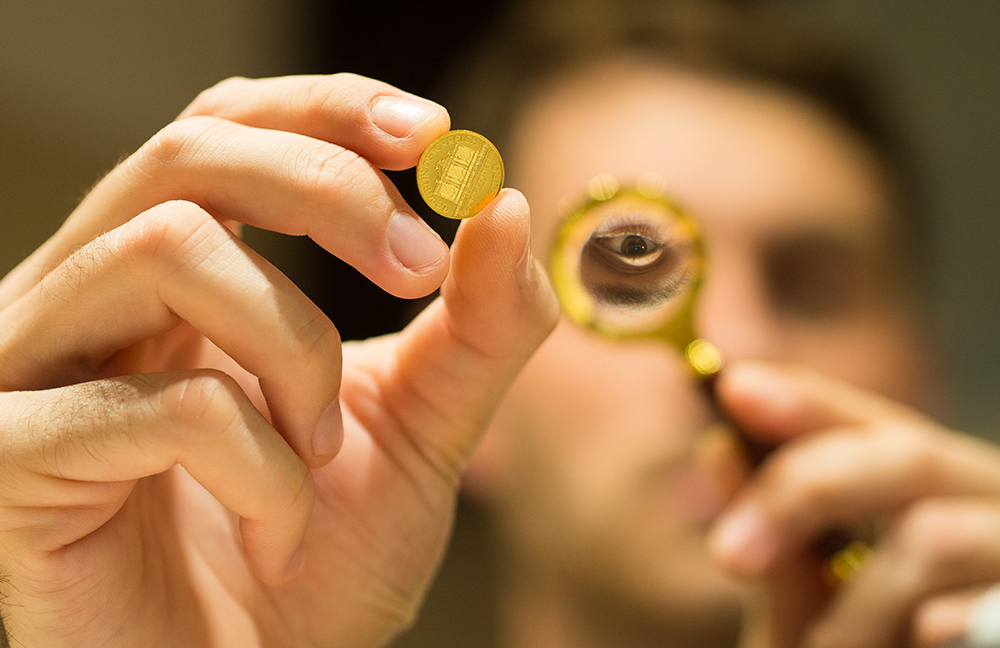 man inspecting gold